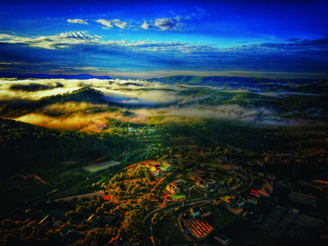 Foggy Mountains and beautiful sunrise in Da Lat