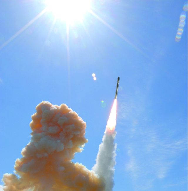 Missile shooting into the blue sky
