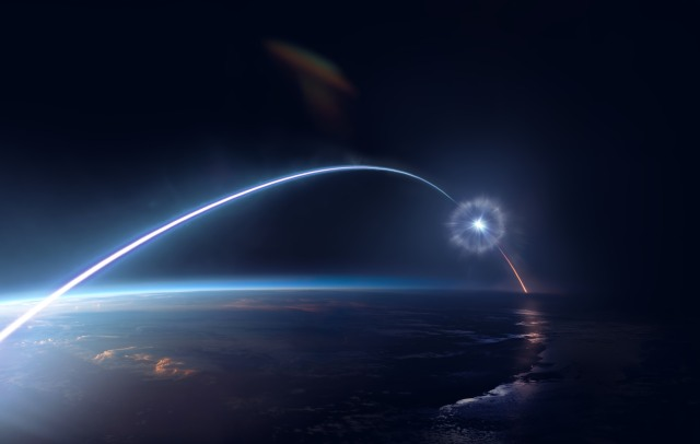 Twilit sky in space with a bright streak arching over Earth's atmosphere