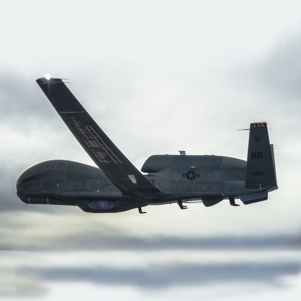aircraft inflight against dark clouds