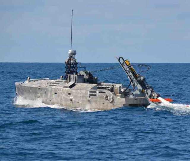 minehunter being deployed from combat ship