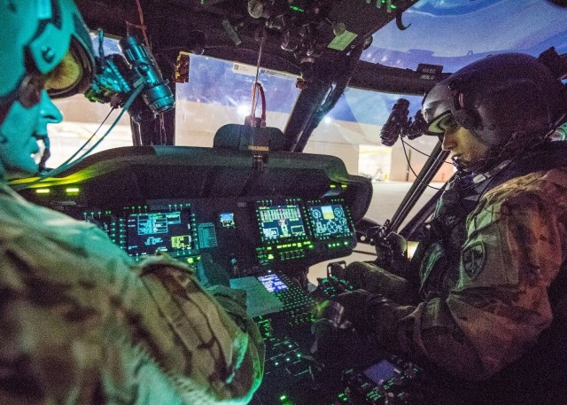 military helicopter cockpit with pilots