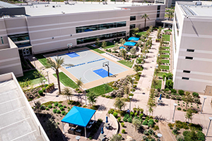 Aerial image of multi-level office building including a basketball court.