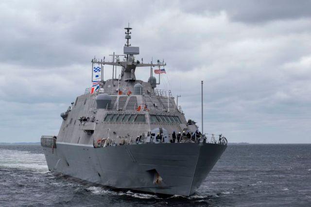 Military ship sailing through the ocean