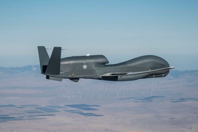 unmanned aircraft flying in blue skies