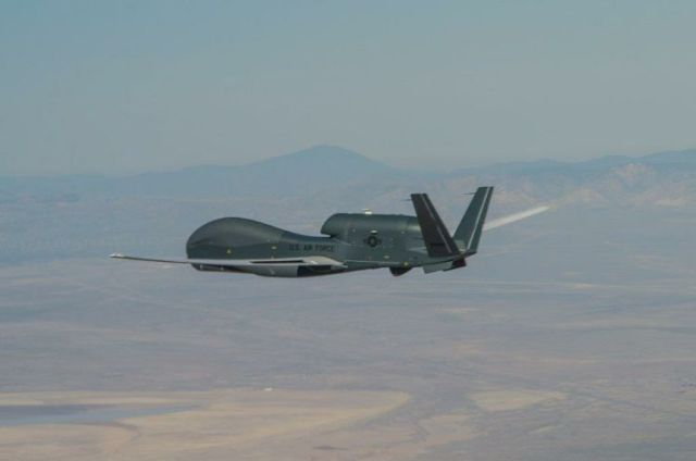 Global Hawk unmanned plane flying over desert