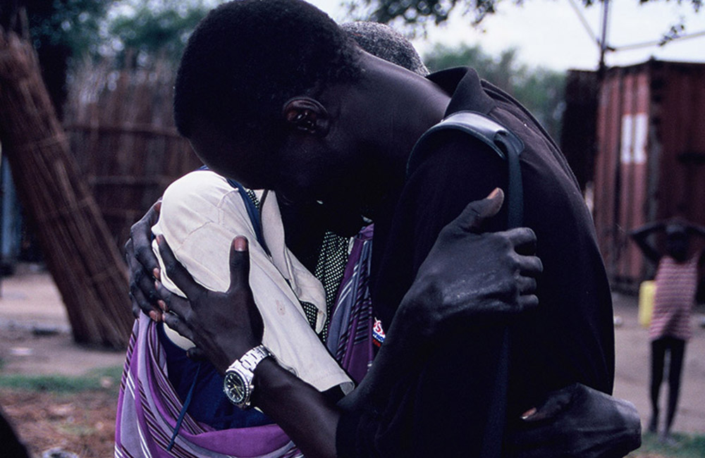 African American Male hugging mother