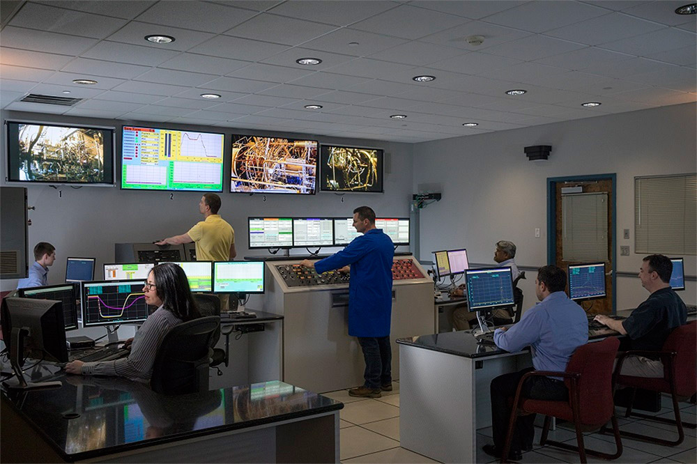 Workers in a control room.
