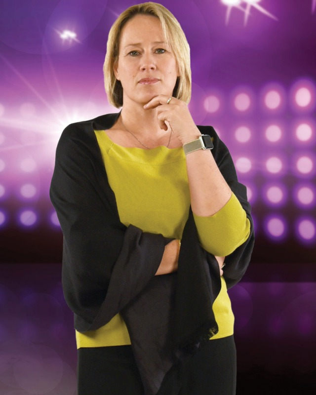 Woman Standing in Front of Purple Background