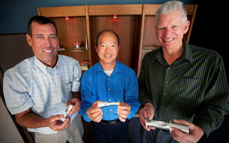 Three Males holding polarizers with their hands