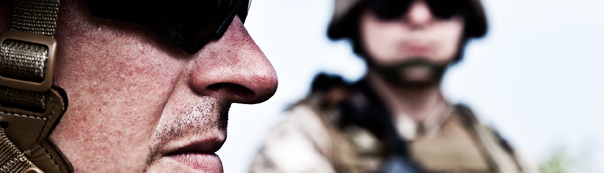 Close-up with two male military soliders