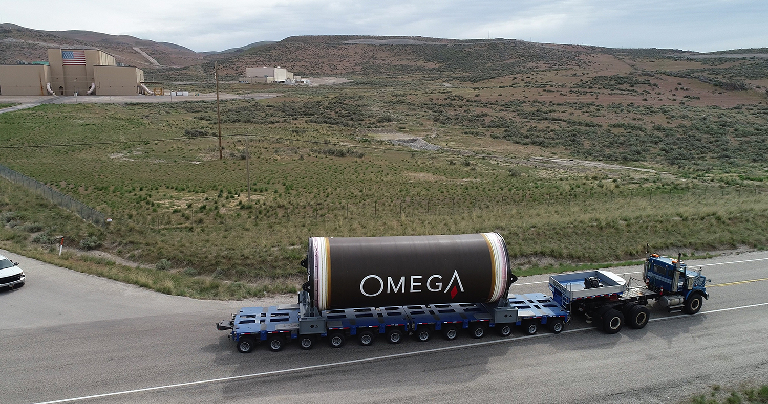 "A ""pathfinder"" OmegA segment travels from Promontory to Corinne, Utah, where it will be loaded on a railcar and shipped to Kennedy Space Center. There the OmegA team will use it to practice stacking and processing operations before the flight segments arrive. (May 2020)"
