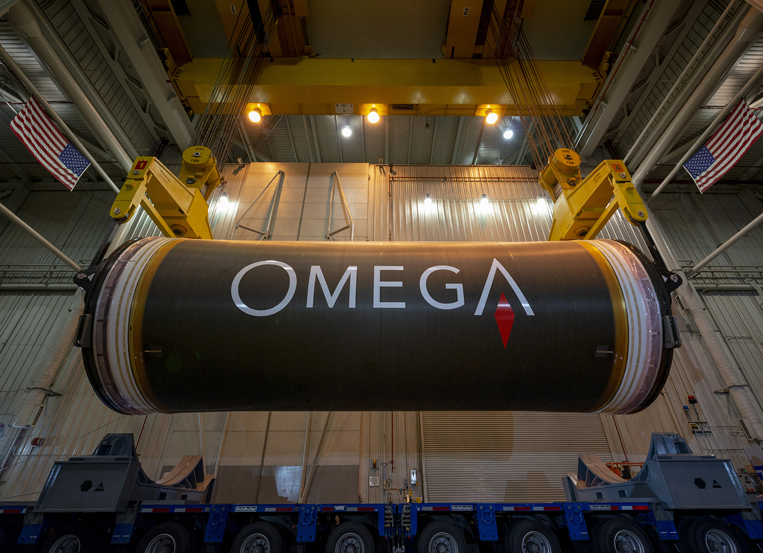 Inert OmegA segments are loaded and shipped to Kennedy Space Center for stacking and integration practice. (May 2020)