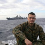 Man in military uniform with ship in background