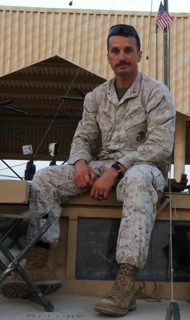Man sitting in uniform