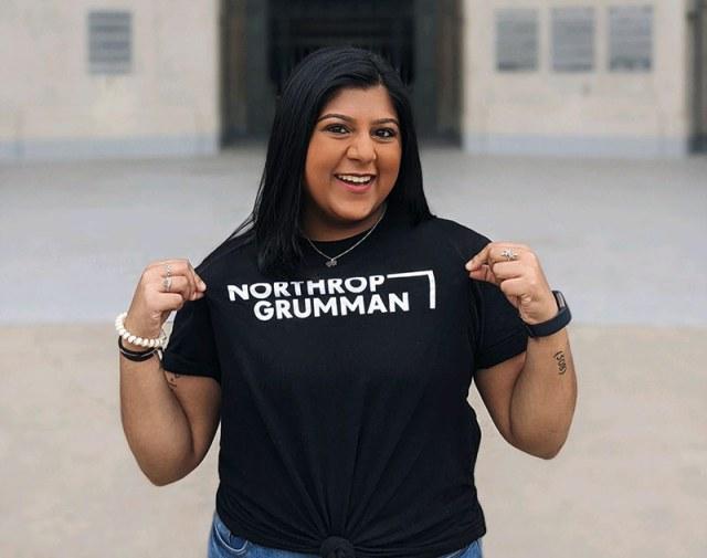 Young woman intern wearing Northrop Grumman t-shirt