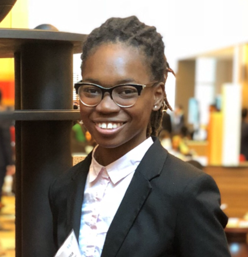 Young Black woman in business attire smiling