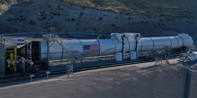 rocket booster on the ground laying horizontally