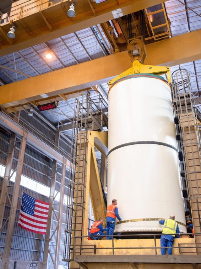 Engineers work to remove and transport the center segment from the casting pits at the Promontory facility.