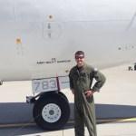 Man in uniform in front of plane
