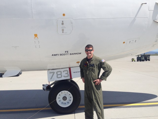 Man in uniform in front of plane
