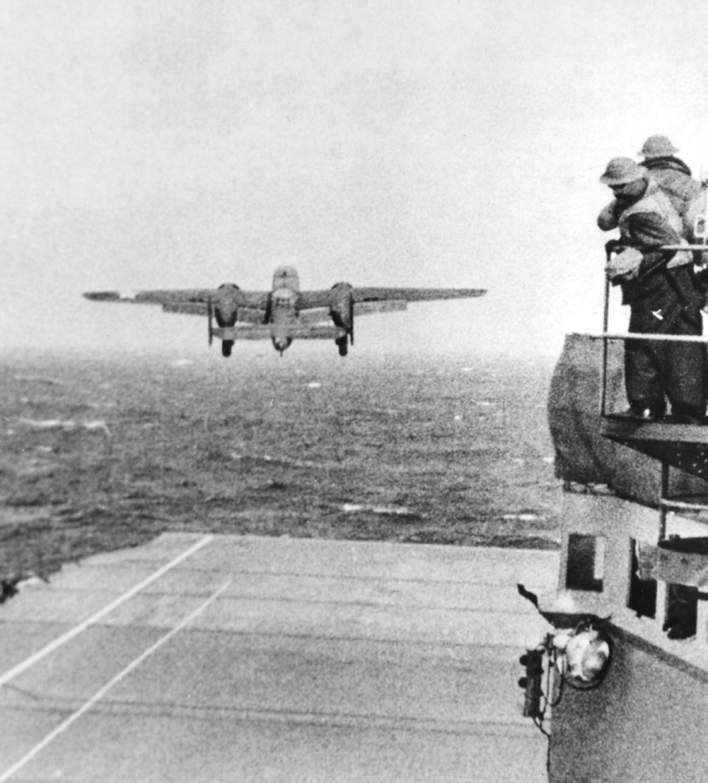 bomber taking off from an aircraft carrier
