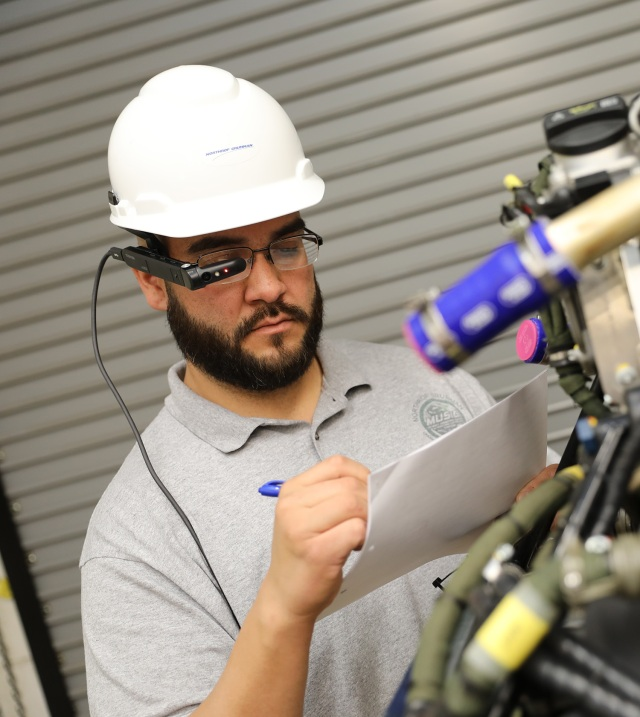 Advanced manufacturing Engineer wearing hard hat and electronic glasses