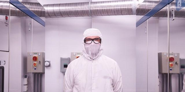 man in clean suit in clean room