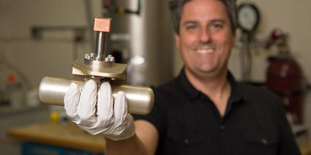 man holding cryocooler