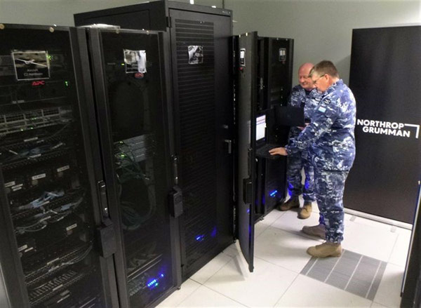 Two men checking out a computer bank