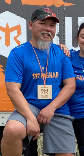 man with beard in blue t-shirt