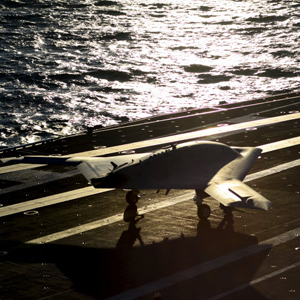 X-47B on the runway on aircraft carrier