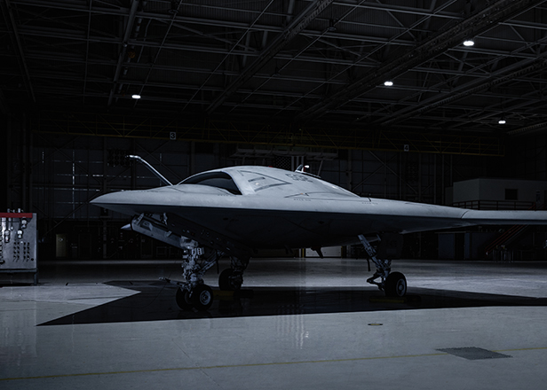 Dark spotlight effect on large aircraft in hanger