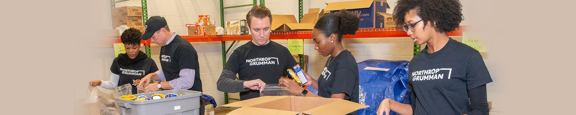 employees volunteering at a food bank