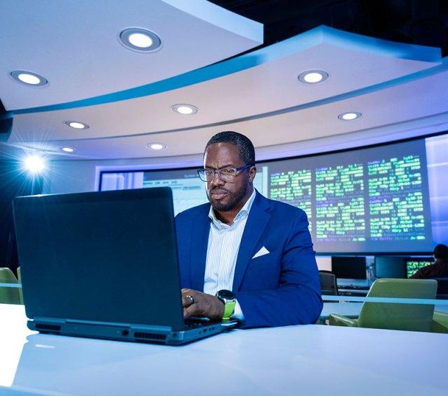 african american man typing on laptop