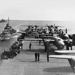 fleet of planes on a carrier