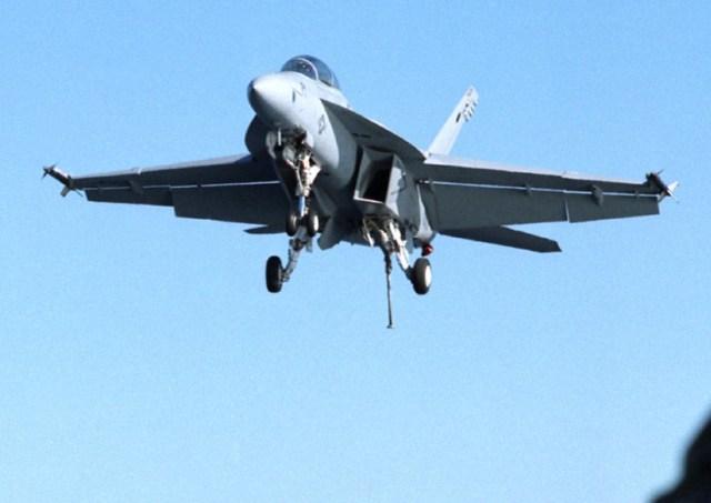 Fighter jet flying in blue sky