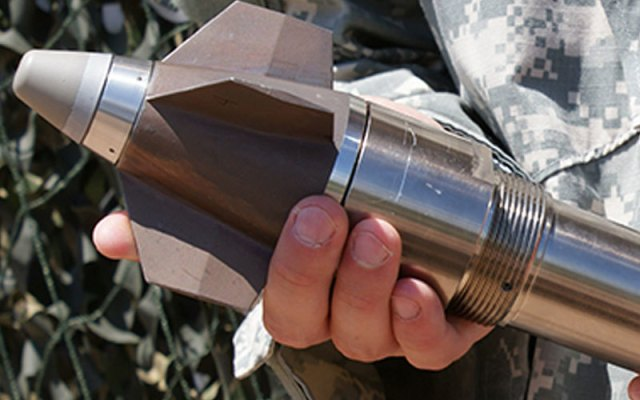 hand holding guided projectile
