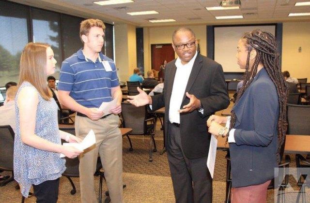 A group of interns meet a Northrop Grumman employee at orientation