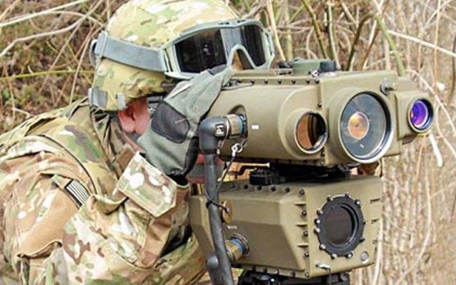 soldier looking thourgh viewfinder of lightweight laser designator rangefinder (lldr)
