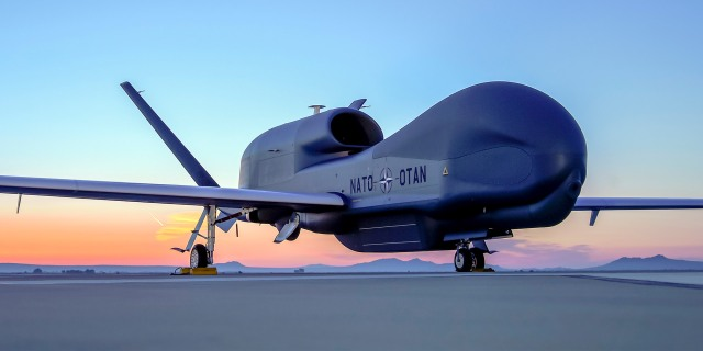 Unmanned plane on tarmac at sunset