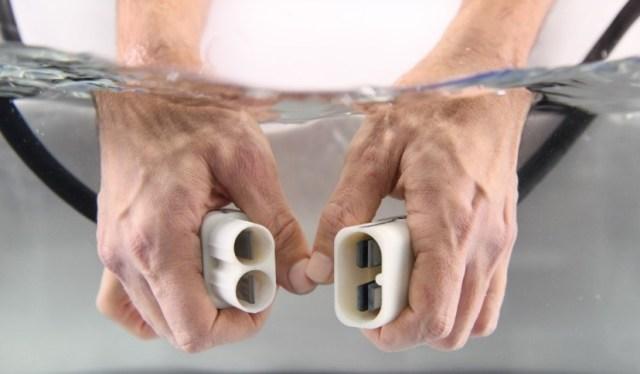 hands enabling underwater power transfer