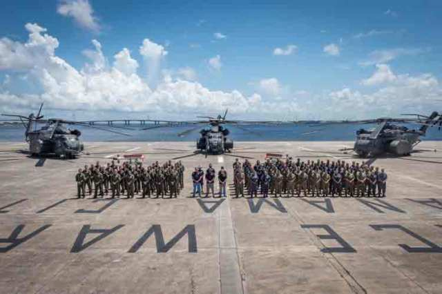 3 MH-53E helicopters and personnel after the successful AQS-24C trials held in Panama City