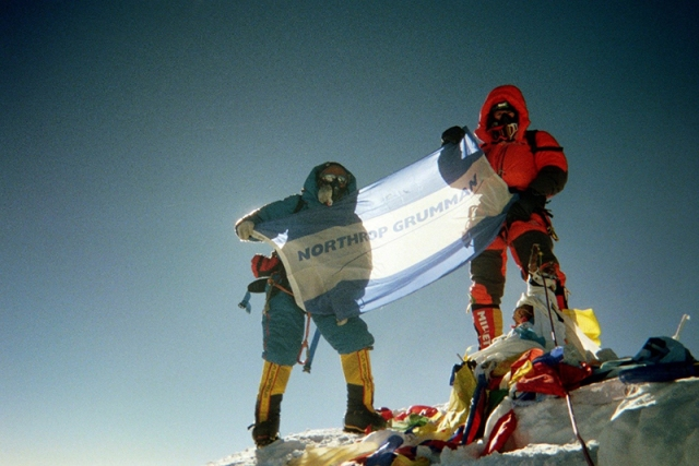 Northrop Grumman engineer summits Mt. Everest and displays the northrop grumman flag.