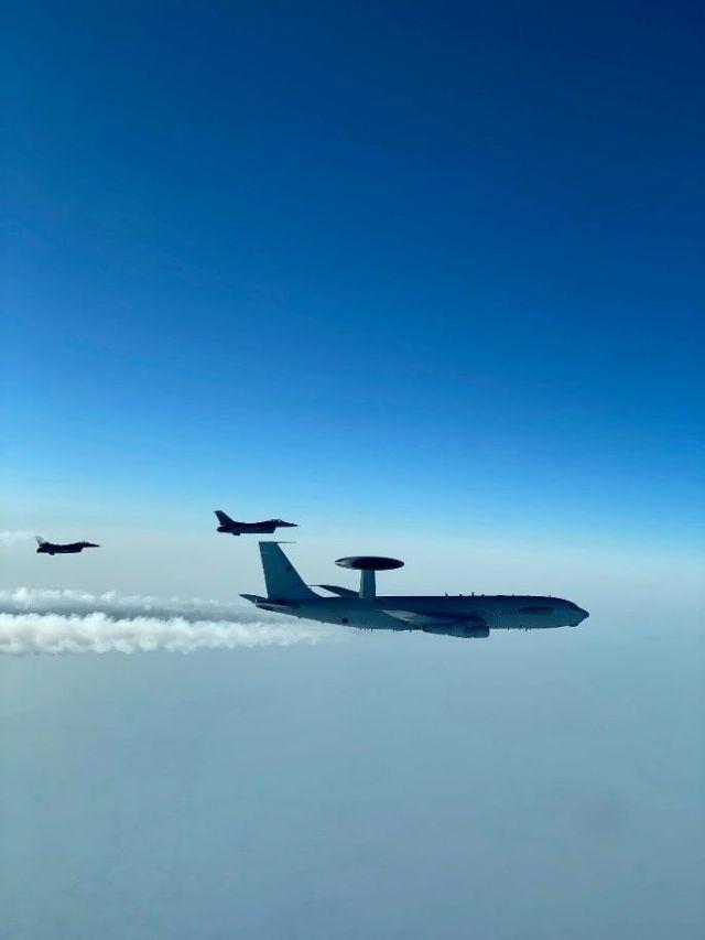 F-16 viper aircraft and E-3 sentry aircraft in flight