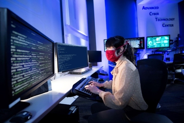 women reading multiple computer screens
