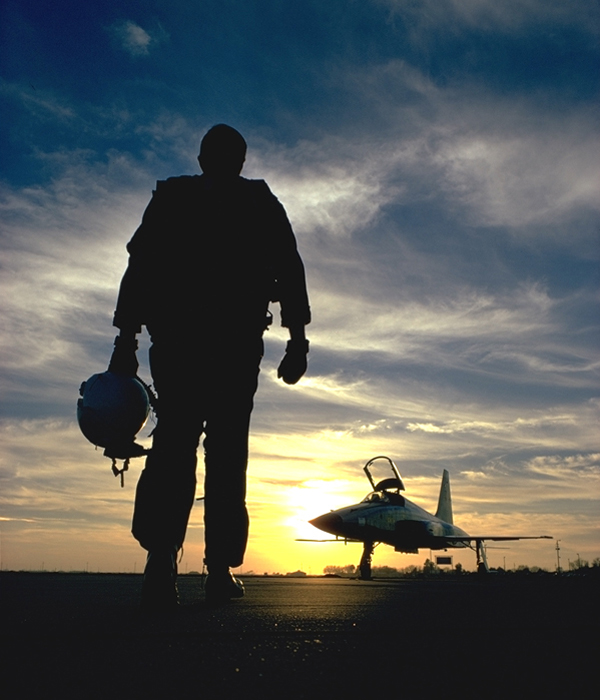 Sunset View of F-5 with pilot looking at F-5 and the Sunset