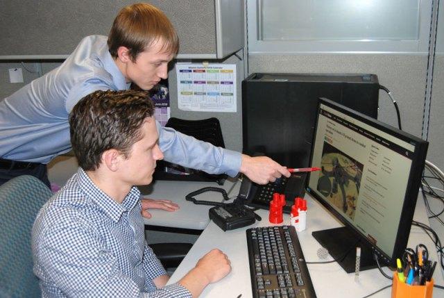 Two Northrop Grumman interns look at a computer together