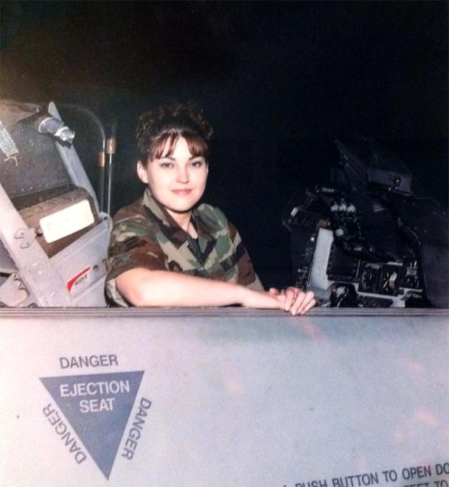 female soldier in cockpit