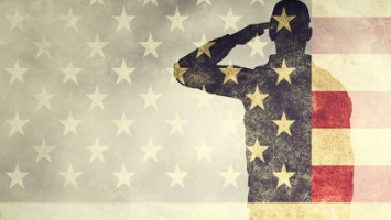 Silhouette saluting american flag